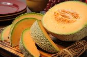 foto of cantaloupe  - Fresh sliced cantaloupe on a cutting board - JPG