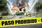 Spanish Paso Prohibido Tape With Firefighters And A Burning House