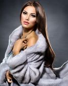 Beauty Fashion Model Girl in Blue Mink Fur Coat. Beautiful Luxury Winter Woman. Grey Mink Jacket Wea