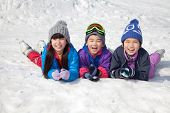 Children Lying on the Snow