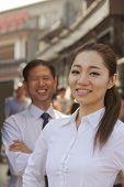 Portrait of two Business People, focus on businesswomen, outdoors, Beijing