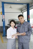 Garage Mechanic Explaining to Customer