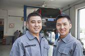 Portrait of Two Garage Mechanics