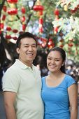 Portrait Of Smiling Couple In Nanluoguxiang, Beijing