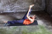 fusion of mind and body - caucasian man on mat practicing pilates