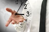 image of punctuality  - Businessman navigating virtual clock in interface - JPG