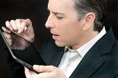 Businessman Uses Tablet, Side Profile