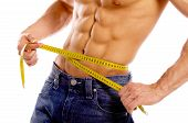 foto of fitness man body  - Muscular and tanned male body parts is being measured - JPG
