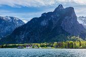Travel Germany concept background - Koningsee lake and St. Bartholomew's Church in Bavarian Alps, Berchtesgaden, Bavaria, Germany