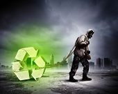 Stalker against nuclear background. Disaster and pollution. Recycle concept