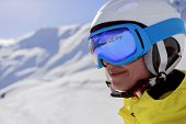 Skier, skiing, winter sport - portrait of beautiful female skier