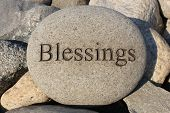 stock photo of blessed  - Positive reinforcement word Blessings engrained in a rock - JPG