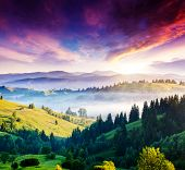 Majestic mountain landscape with colorful cloud. Dramatic overcast sky. Carpathian, Ukraine, Europe. Beauty world.