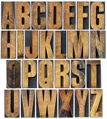 complete English alphabet - a collage of 26 isolated vintage wood letterpress printing blocks, scrat