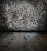 Grunge stone room. wall full of cracks.