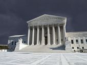 Supreme court building exterior with thunderstorm sky in Washington DC, USA.