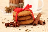 Cookies for Santa: Conceptual image of ginger cookies, milk and christmas decoration on light backgr