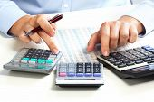 stock photo of calculator  - Hand with calculator - JPG