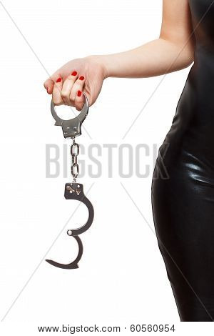 Dominatrix Holding Handcuffs poster