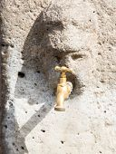Brass Faucet In Pompeii Stone Face