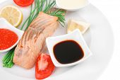 sea food : roasted wild salmon fillet with chives, lime, red caviar, soybean sauce on white dish iso