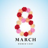 Happy Women's Day celebrations concept with beautiful colorful flowers decorated 8th March on blue b