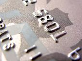 Numbers of golden credit card in very close up