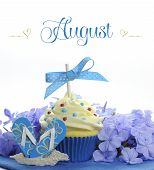 Beautiful Blue Summer Holiday Theme Cupcake With Seasonal Flowers And Decorations For The Month Of A