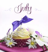 Beautiful Purple And Pink Summer Theme Cupcake With Seasonal Flowers And Decorations For The Month O