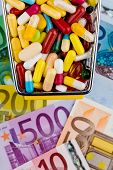 tablets, shopping cart, euro bills, symbolic photo for pharmaceuticals, health insurance, health car