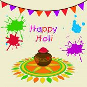 Indian festival Happy Holi celebrations concept with beautiful traditional mud pot with full of colours on abstract background.