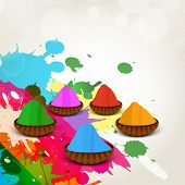 Indian colour festival Happy Holi celebrations concept with colour powders on splash background.