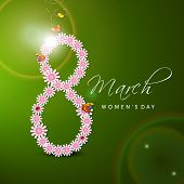 International Happy Women's Day celebration concept with floral decorated 8th March on green background.
