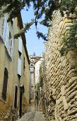 foto of corbel  - Narrow street toward Gordes Castle in the Luberon - JPG