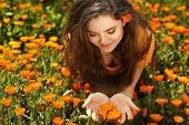 Beauty Woman Portrait With Flowers. Free Happy Brunette Enjoying Nature. Enjoyment. Freedom Concept.