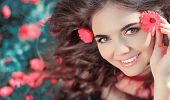 Beauty Woman Portrait With Flowers. Free Happy Girl Enjoying Nature. Beauty Teen Over Marigold Flowe