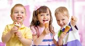 happy children or kids group with ice cream
