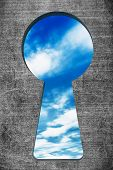 foto of latency  - Blue sky seen through the keyhole on a stone background - JPG