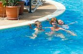 Family In The Swimming Pool.
