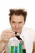 foto of mad scientist  - A mad scientist is mixing some chemicals - JPG