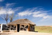 picture of mud-hut  - traditional african hut of the ndebele tribe with mud walls and thatch roof and decorated walls - JPG