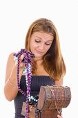 Undecided Girl Takes Out Jewelery From Jewelry Box
