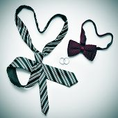 a tie and a bow tie forming hearts and wedding rings, depicting the gay marriage concept, with a retro effect