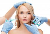 beauty and cosmetic surgery concept - woman face and beautician hands with syringes