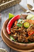 Mee goreng mamak or mi goreng, Indonesian and Malaysian cuisine, spicy fried noodles with wooden din