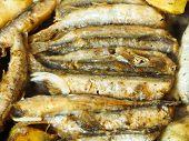 Frying Capelin Fish In Oil In Frypan