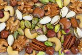 Selection of nuts, almonds and sultanas, close up