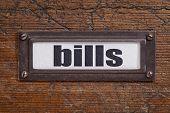 bills  - file cabinet label, bronze holder against grunge and scratched wood