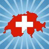 Switzerland map flag on blue sunburst illustration