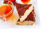 black english tea and cakes with red cherry